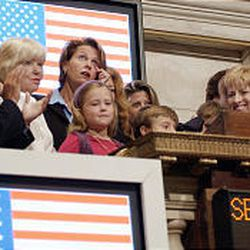 Family members of those who died on 9/11 join in the opening bell ceremonies.