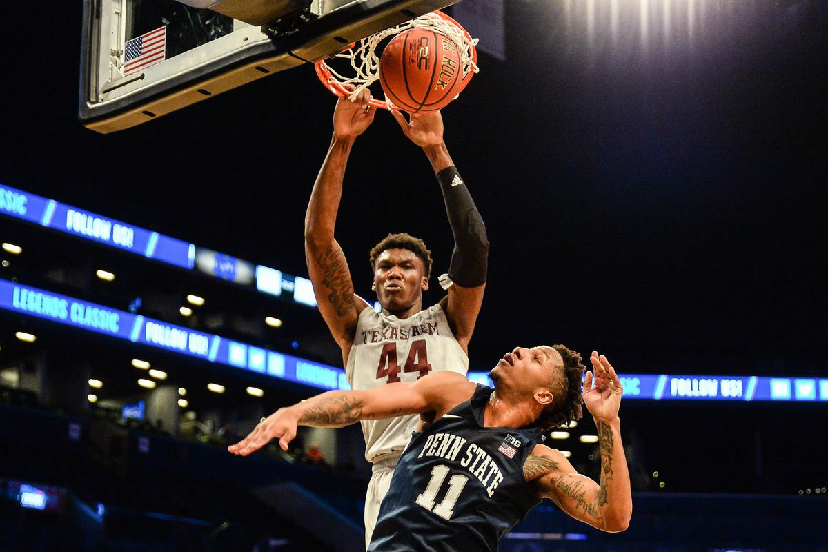 Nov 21, 2017; Brooklyn, NY, USA; Texas A&M Aggies forward Robert Williams (44) dunks a rebound over Penn State Nittany Lions forward Lamar Stevens (11) during the first half of the Legends Classic at the Barclays Center. Mandatory Credit: Dennis Schneidler-USA TODAY Sports