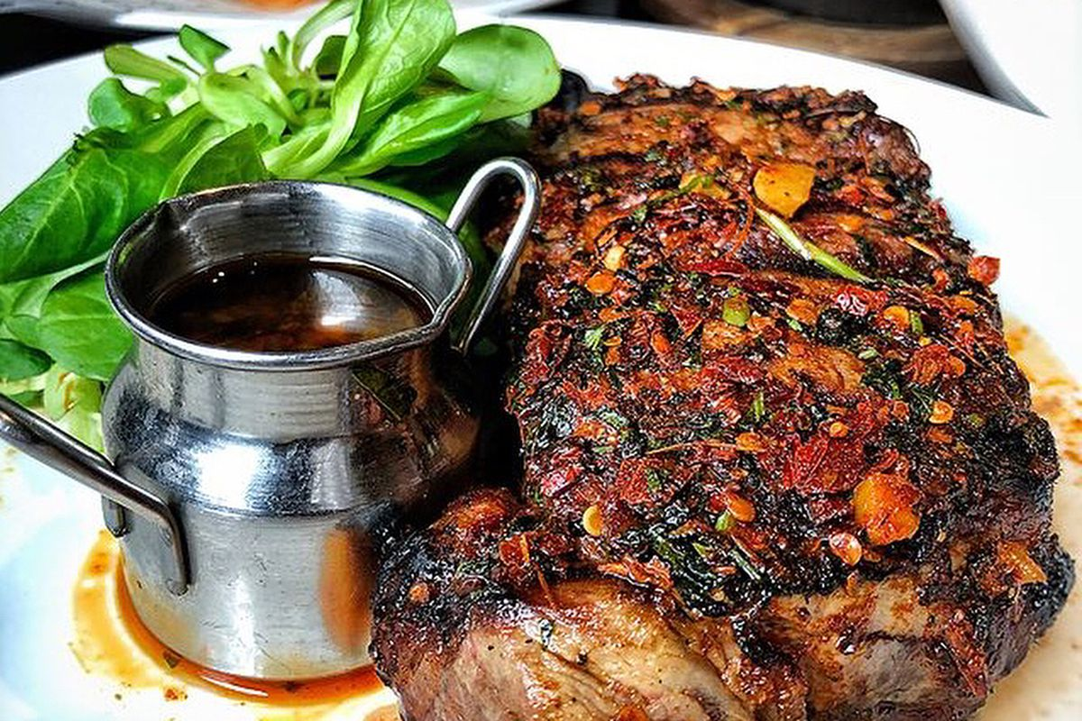 Steak with chimichurri sauce and watercress at CAU restaurant in Wimbledon, London