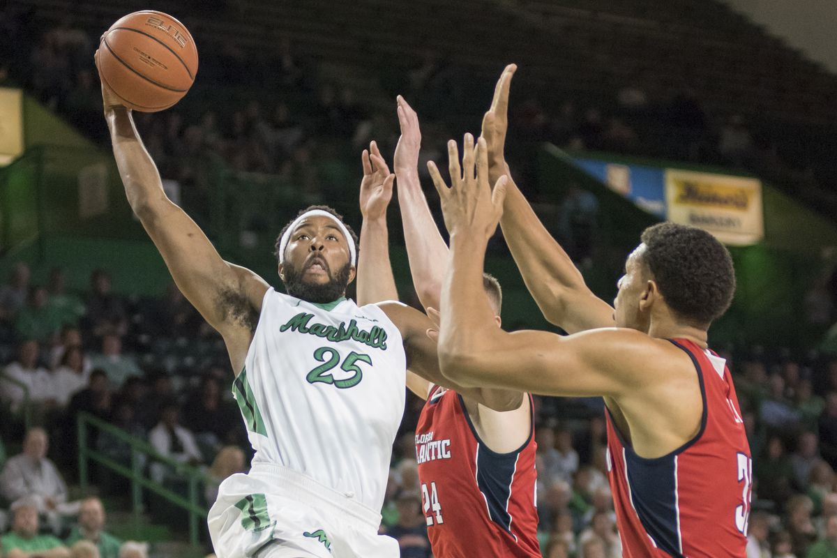 Marshall's Ryan Taylor (25) elevates over FAU's Ronald Delph (33).