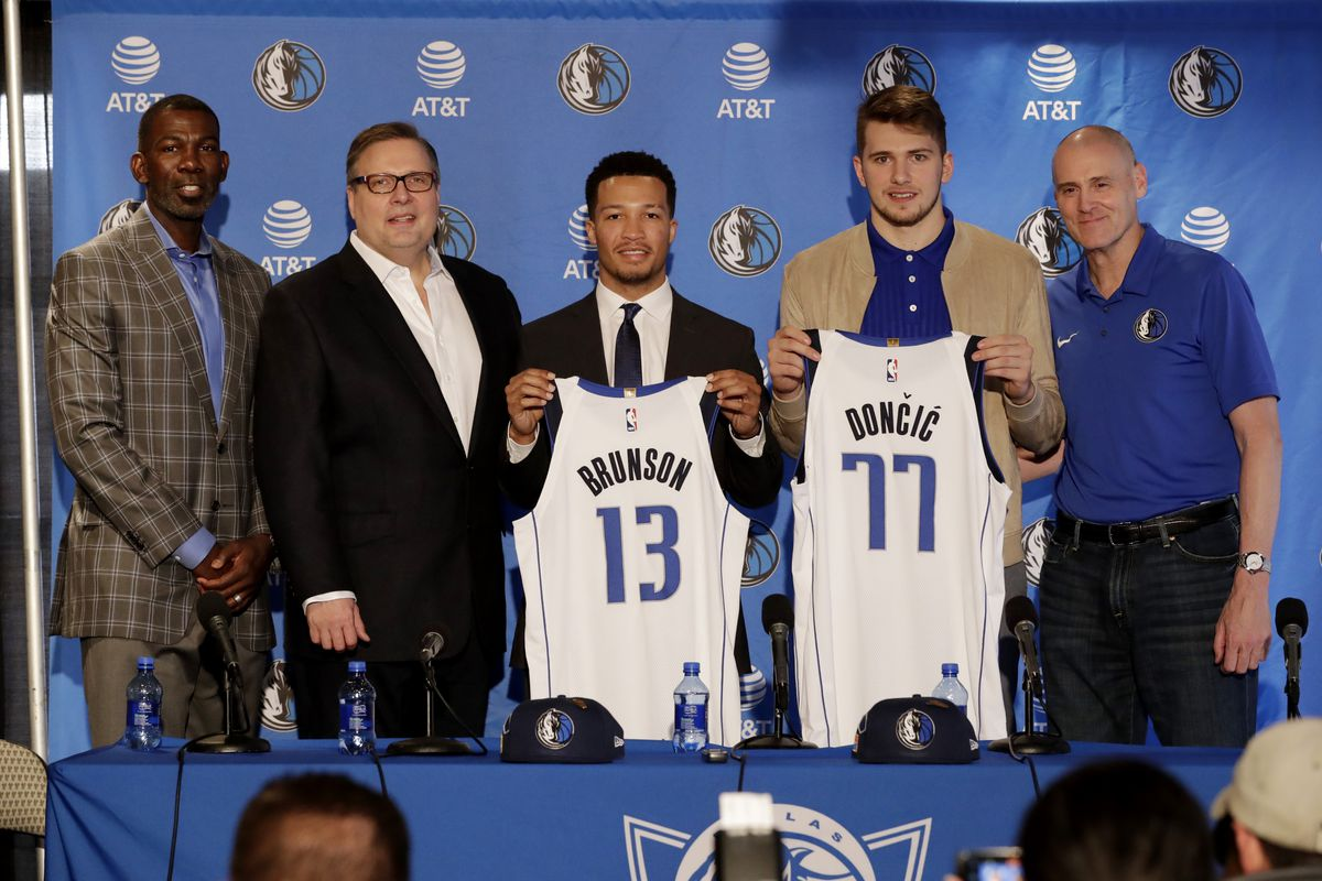 Michael Finley Donnie Nelson Draft Picks Jalen Brunson Luka Doncic and Dallas Mavericks Head Coach Rick Carlisle pose for a photo at the Post NBA Draft press conference on June 22, 2018 at the American Airlines Center in Dallas, Texas.