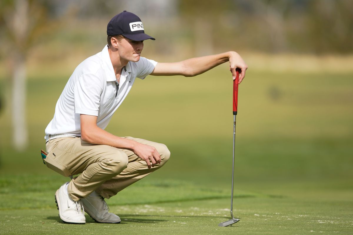 Morgan's Tanner Telford competes in the 3A boys state championship at Oquirrh Hills Golf Course.