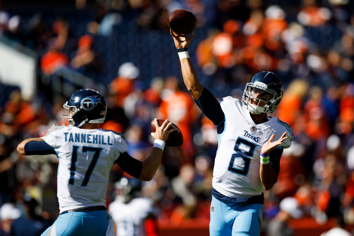 Quarterback Marcus Mariota of the Tennessee Titans and quarterback Ryan Tannehill of the Tennessee Titans warm up before a game against the Denver Broncos at Empower Field at Mile High on October 13, 2019 in Denver, Colorado.