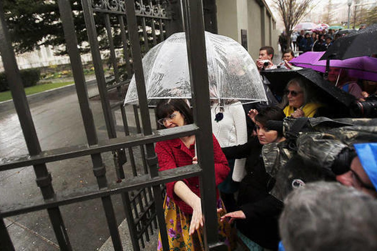 Kate Kelly, founder of Ordain Women, walks through the gate onto Temple Square to the LDS Tabernacle in Salt Lake City, Saturday, April 5, 2014 to ask for entrance into the priesthood session of general conference.