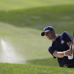 USA's Dustin Johnson hits out of a bunker on the seventh hole at the Ryder Cup PGA golf tournament Tuesday, Sept. 25, 2012, at the Medinah Country Club in Medinah, Ill.