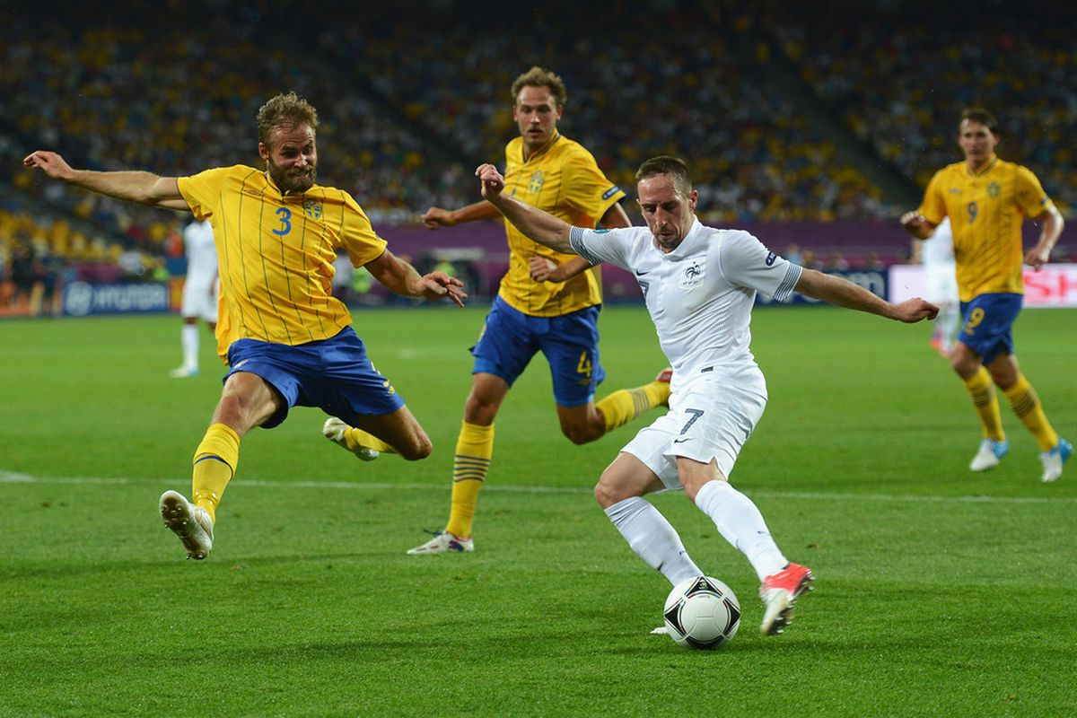 KIEV, UKRAINE - JUNE 19:  Franck Ribery of France is challenged by Olof Mellberg of Sweden during the UEFA EURO 2012 group D match between Sweden and France at The Olympic Stadium on June 19, 2012 in Kiev, Ukraine.  (Photo by Lars Baron/Getty Images)