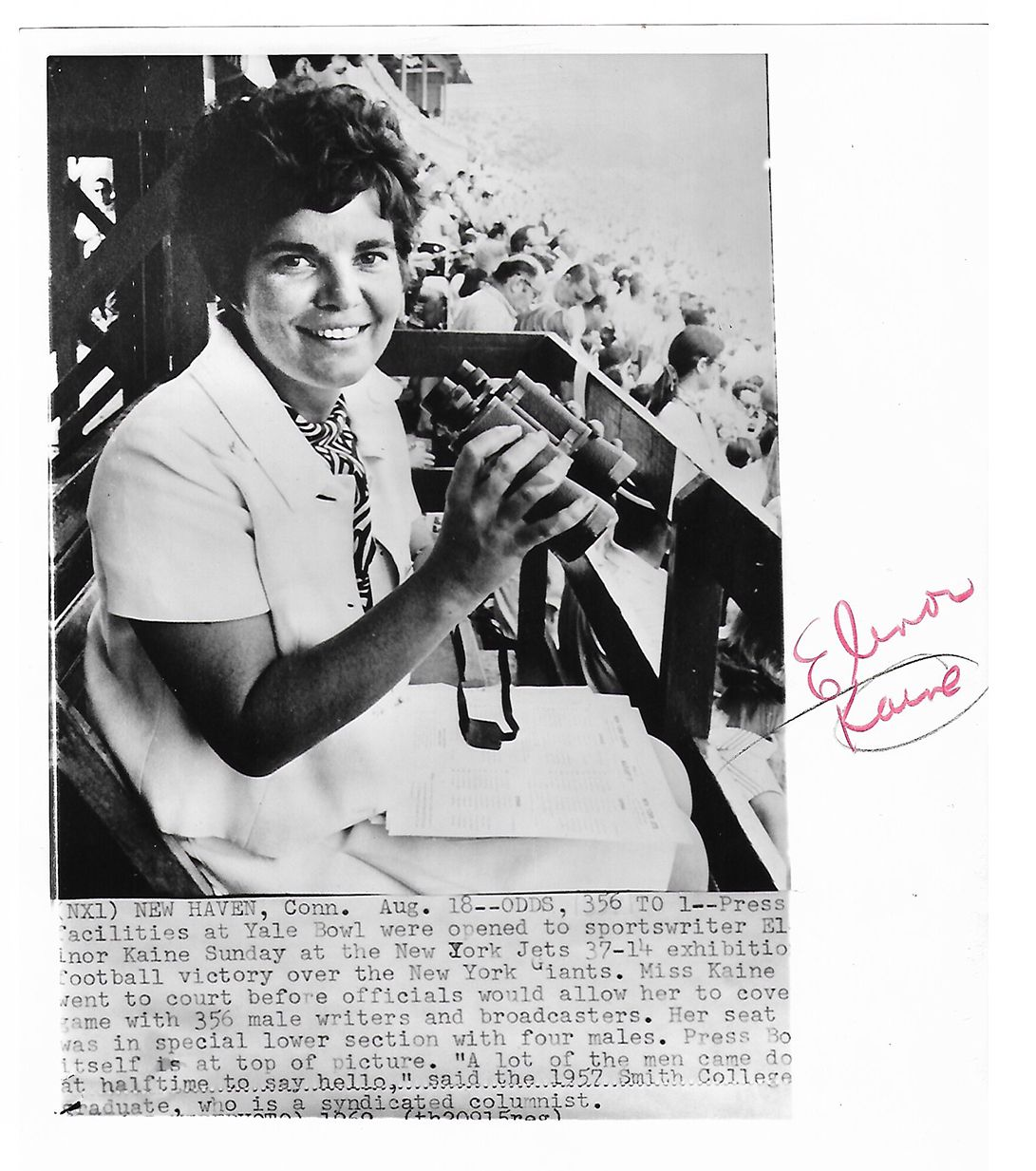photo clipping of Elinor holding binoculars at a game