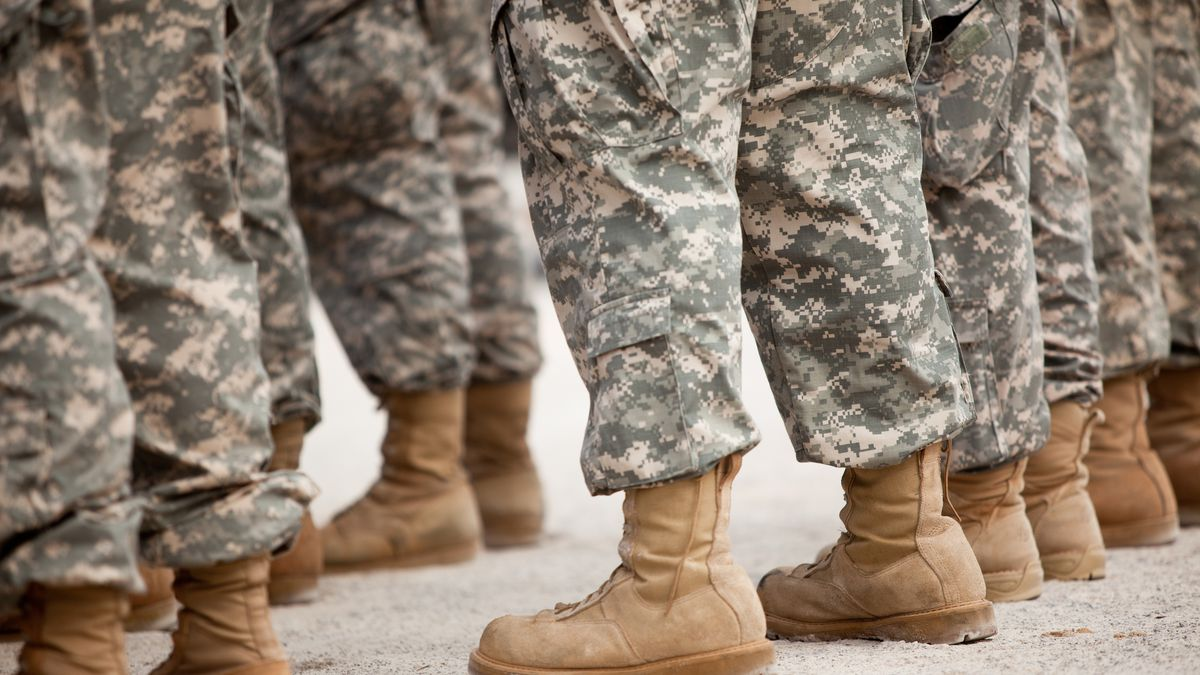 Army fatigues and boots.
