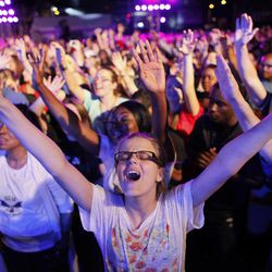 """Dharma Bohall, 13, extends her arms in prayer during the America for Jesus prayer rally, Friday Sept. 28, 2012, on Independence Mall in Philadelphia. Christian conservatives who blame """"moral depravity"""" for everything from the recession to terrorism are converging on Philadelphia for a rally they hope will spark a religious revival as Election Day nears."""