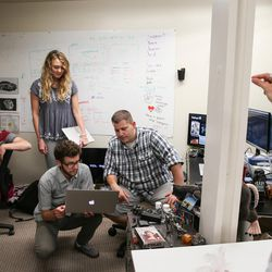 Members of the tech and marketing teams Yenn Lei, Madeleine Flynn, Nate Hardyman and Jed Ashford, left to right, discuss the design for a new web feature with Jeffrey Harmon, cofounder and CMO, right, at VidAngel's office in Provo on Wednesday, July 20, 2016.