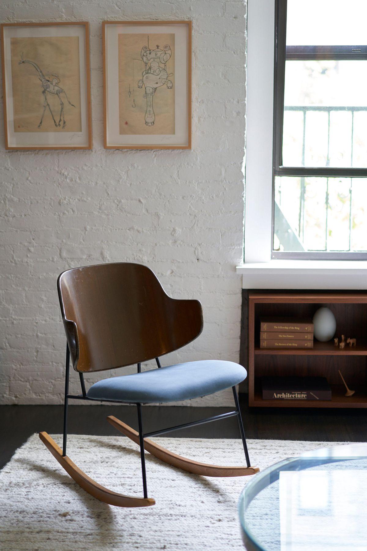 A rocking chair near a window.