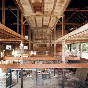 <p>By August, the interior of the barn was nearly gutted, leaving its exposed timber frame and soaring ceiling intact.</p>