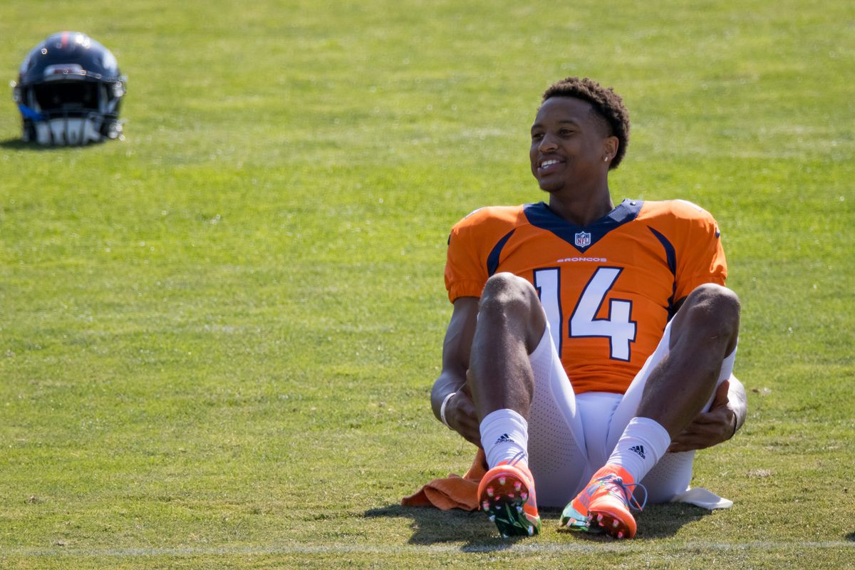 Wide receiver Courtland Sutton of the Denver Broncos smiles while stretching during a training session at UCHealth Training Center on August 17, 2020 in Englewood, Colorado.
