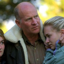 Family members Tom Smart with daughters, Nicole (left) and Sierra Smart attend the Candlelight vigil at Liberty Park for their 14-year old cousin and niece, Elizabeth Smart, who was kidnapped.