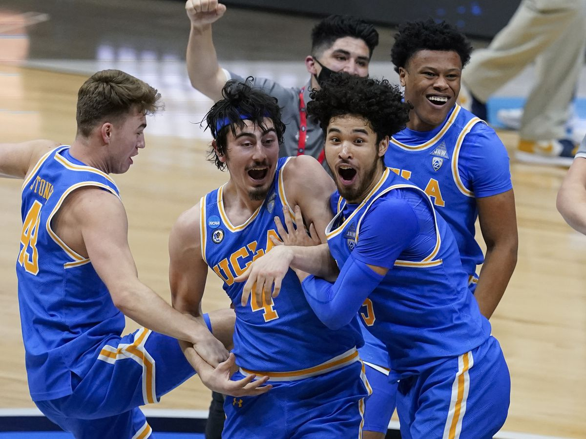 UCLA players celebrate after an Elite 8 game against Michigan at Lucas Oil Stadium, March 31, 2021, in Indianapolis.