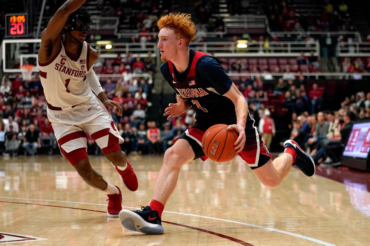 Arizona Wildcats guard Nico Mannion drives against Stanford Cardinal guard Daejon Davis during the second half at Maples Pavilion.