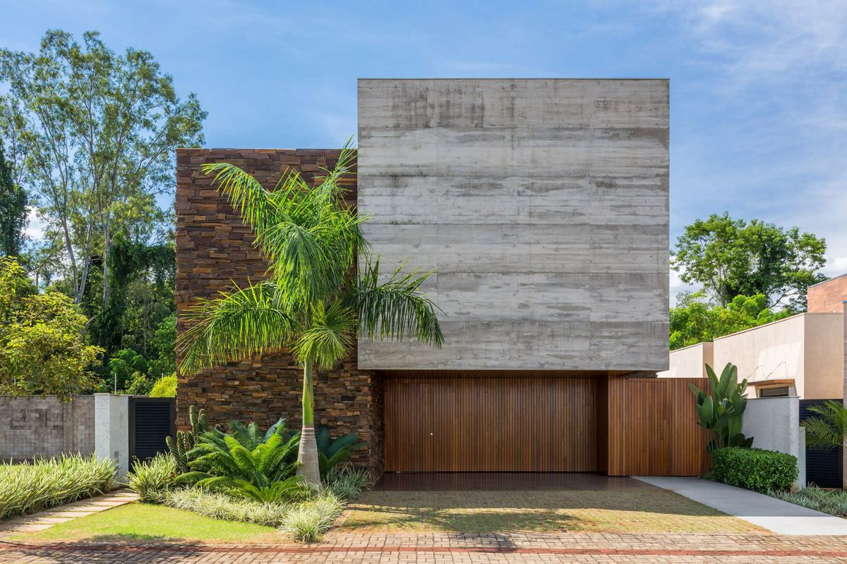 Facade of house made from concrete, wood, and brick