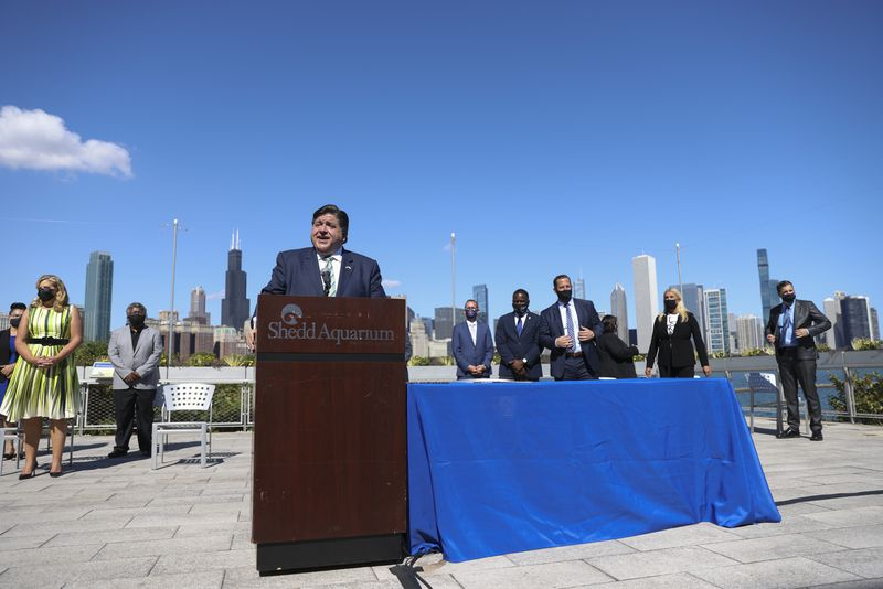 Gov. J.B. Pritzker speaks during a signing ceremony for the the Climate and Equitable Jobs Act at the Shedd Aquarium on Wednesday.