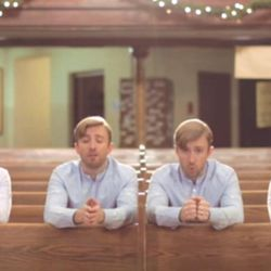 Peter Hollens sings all the parts in his a cappella arrangement in an empty church building.