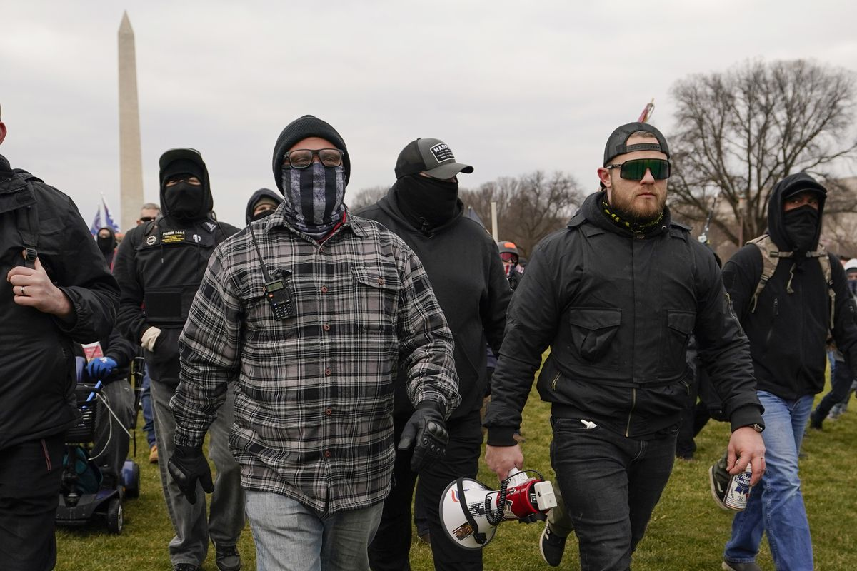 In this Jan. 6, 2021, photo, Proud Boy members Joseph Biggs, left, and Ethan Nordean, right with megaphone, walk toward the U.S. Capitol in Washington, in support of President Donald Trump.