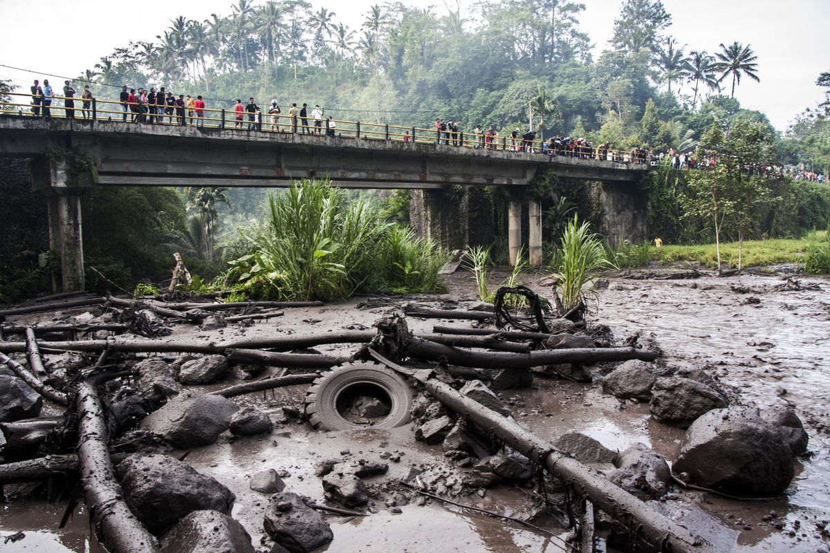 BALI, INDONESIA - NOVEMBER 27: People see cold lava flow amid an eruption of Mount Agung on the river Yeh Sah on November 27, 2017 in Bali, Indonesia.