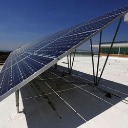 Solar panels on the roof of the Shepherd Union Building at Weber State University in Ogden collect energy on Friday, Aug. 19, 2016.