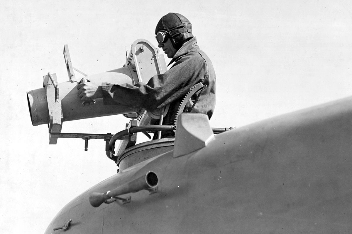 W.L. Richardson taking a photograph from a plane.