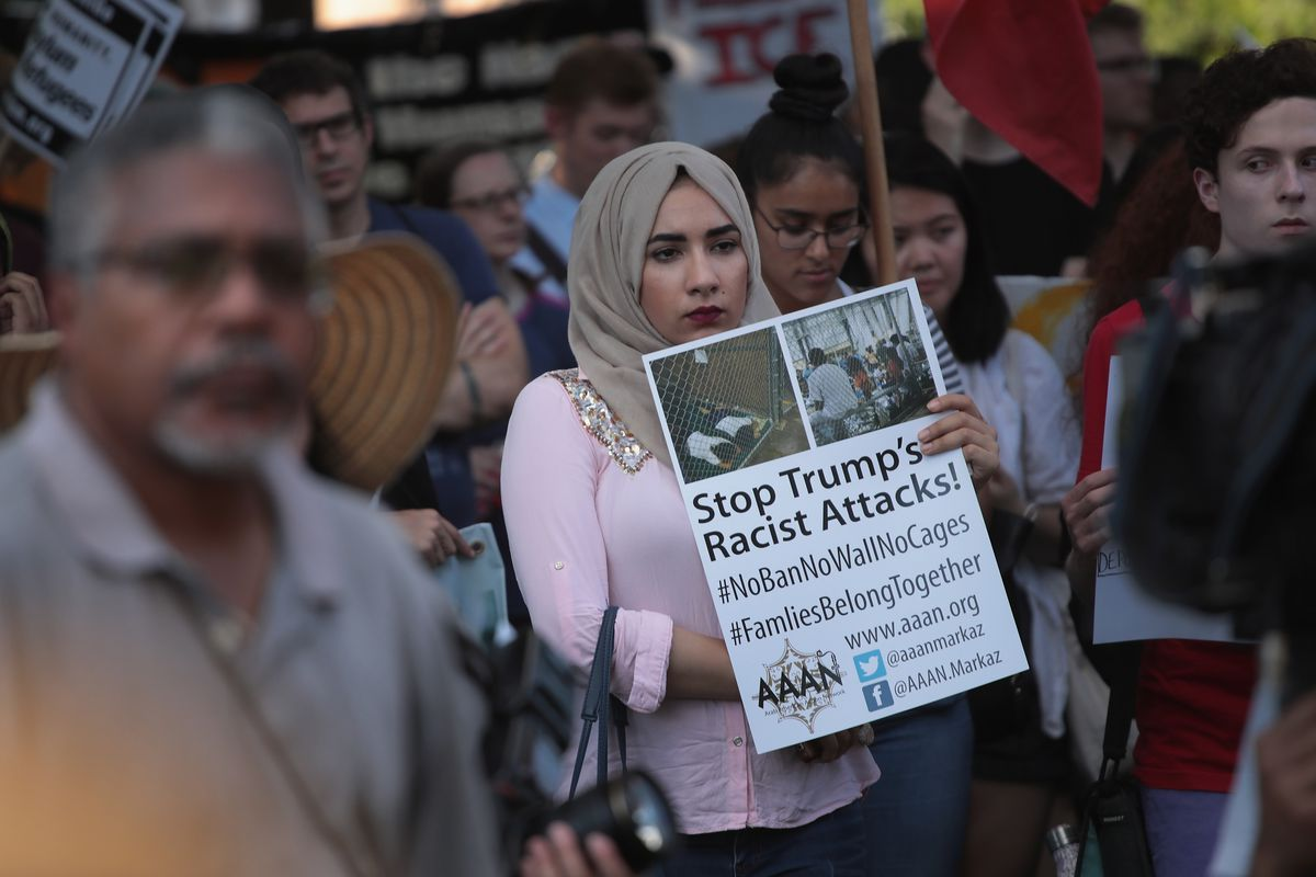 Demonstrators at a June rally in the Little Village neighborhood called for the elimination of the U.S. Immigration and Customs Enforcement. A letter circulating among public school parents warns of unintended consequences of fingerprinting school council members because of concerns over deportations.