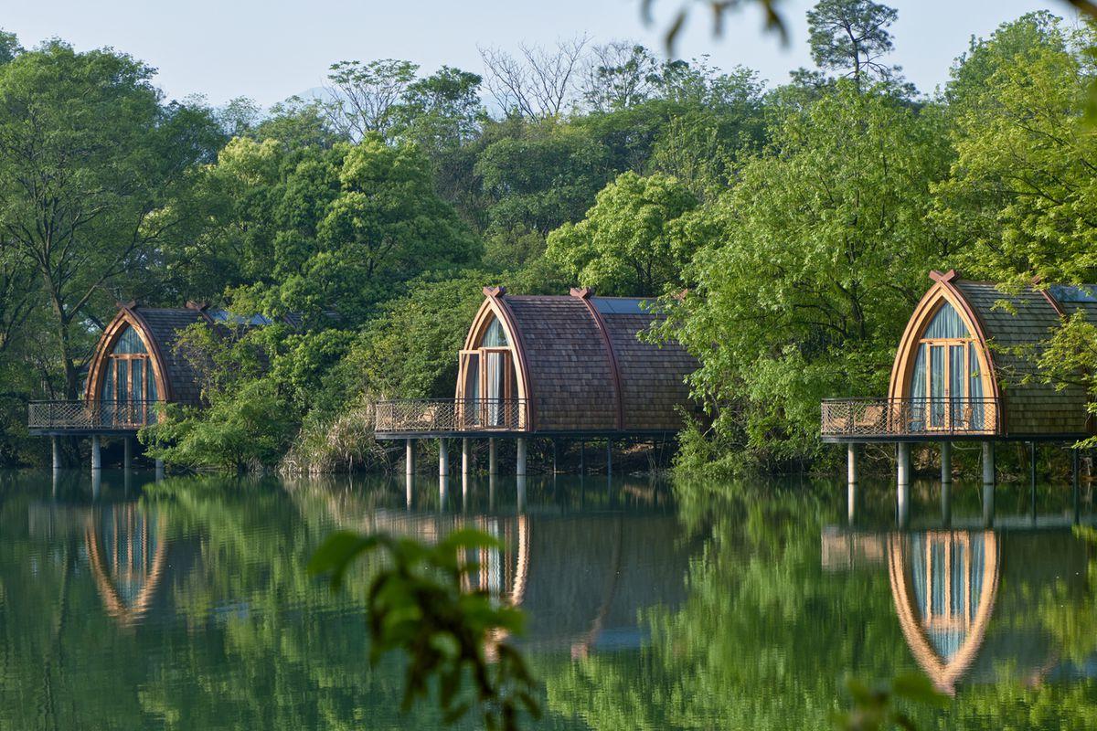 Wooden cabins floating on lake in China