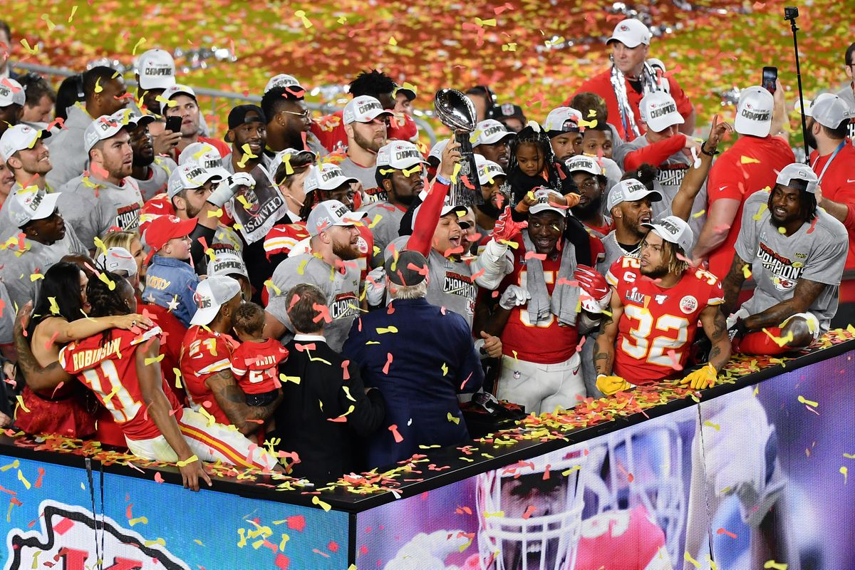 Kansas City Chiefs quarterback Patrick Mahomes holds up the Vince Lombardi Trophy after defeating the San Francisco 49ers in Super Bowl LIV at Hard Rock Stadium.