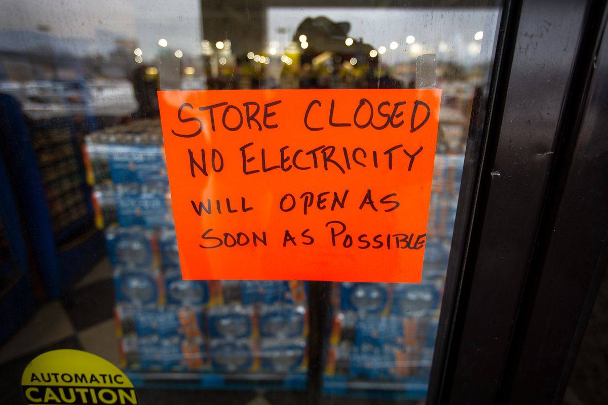 A sign states that a Fiesta Mart is closed because of a power outage in Austin, Texas, on February 17, 2021.