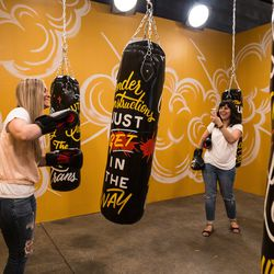 """People take turns hitting the punching bags at Madame Gandhi and Jen Massari's 29Rooms installation """"The Future is Female."""" 