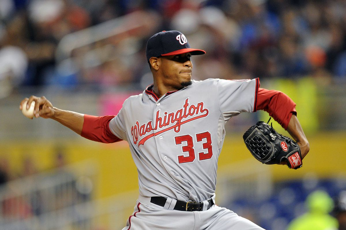 May 29, 2012; Miami, FL, USA; Washington Nationals starting pitcher Edwin Jackson (33) throws in the sixth inning against the Miami Marlins at Marlins Park. Mandatory Credit: Steve Mitchell-US PRESSWIRE