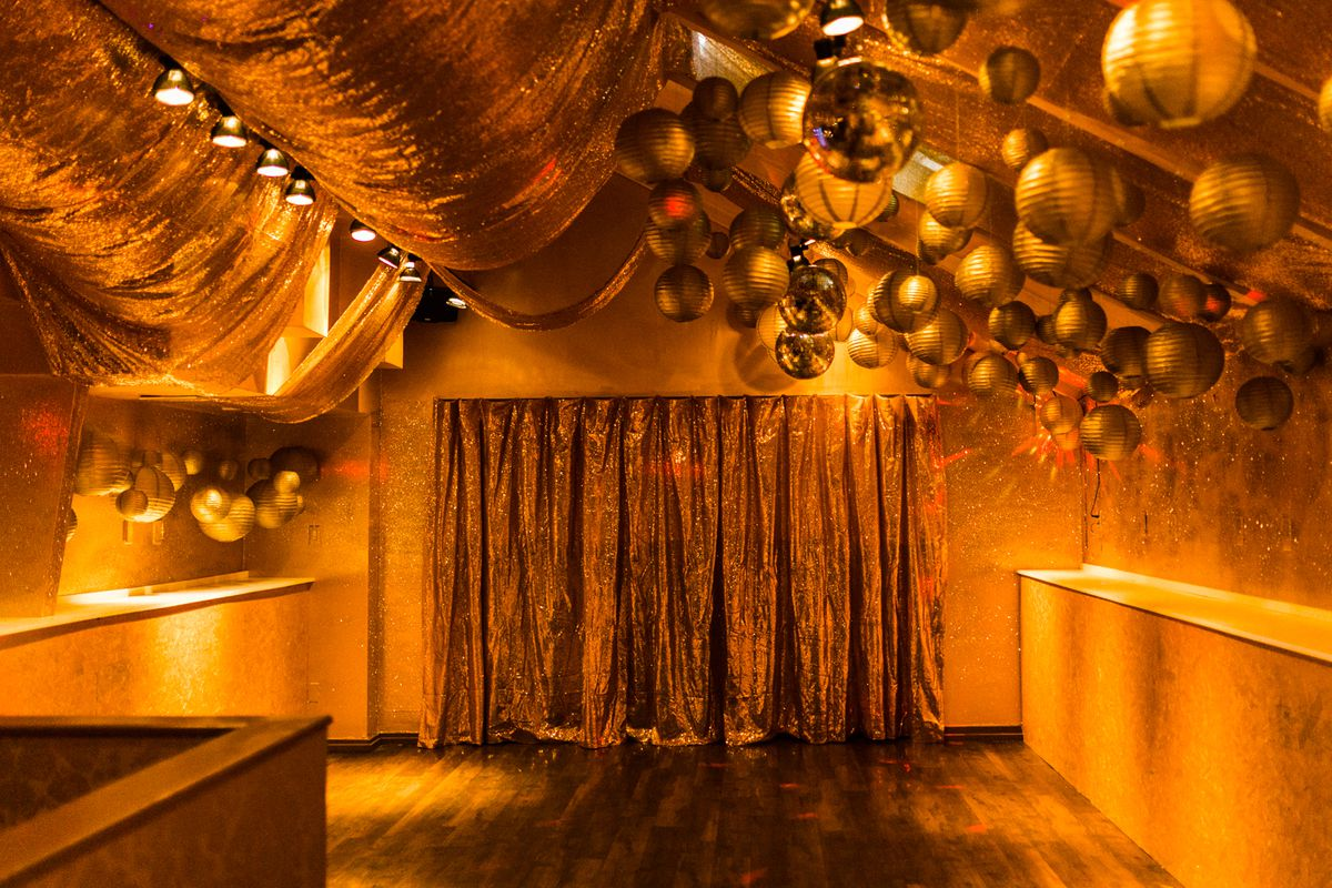 room with dance floor decorated in all gold