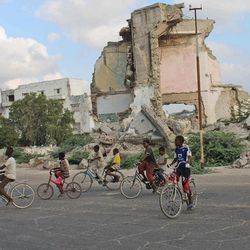 In this photo taken Friday, March 30, 2012, Somali children take ride on their bicycles in Mogadishu, Somalia. The seaside capital of Mogadishu is full of life for the first time in 20 years after African Union and Somali troops pushed Islamist militants out of the city last year.