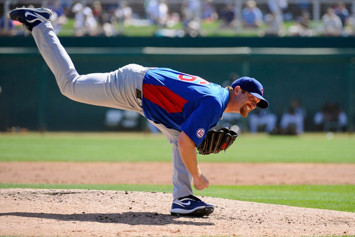 Ryan Dempster of the Chicago Cubs throws a pitch against the Chicago White Sox during a spring training baseball game at Camelback Ranch in Glendale, Arizona.  (Photo by Kevork Djansezian/Getty Images)