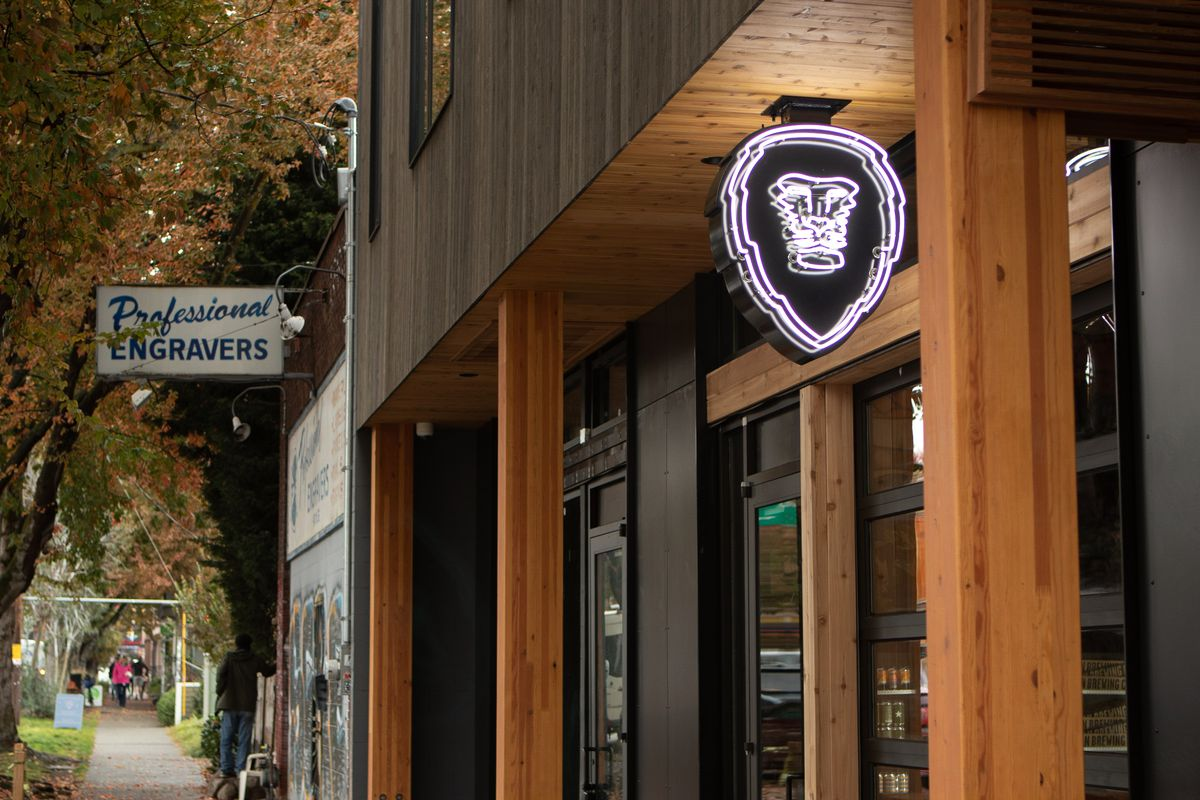 The exterior of Aslan Brewing Company's Fremont location, showing the trademark lionhead sign.
