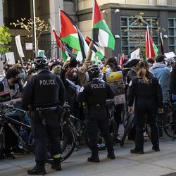 Chicago police officers keep watch as thousands rally in support of Palestine outside the Consulate General of Israel to the Midwest, at 500 W. Madison St., after marching through the Loop, Wednesday evening, May 12, 2021.