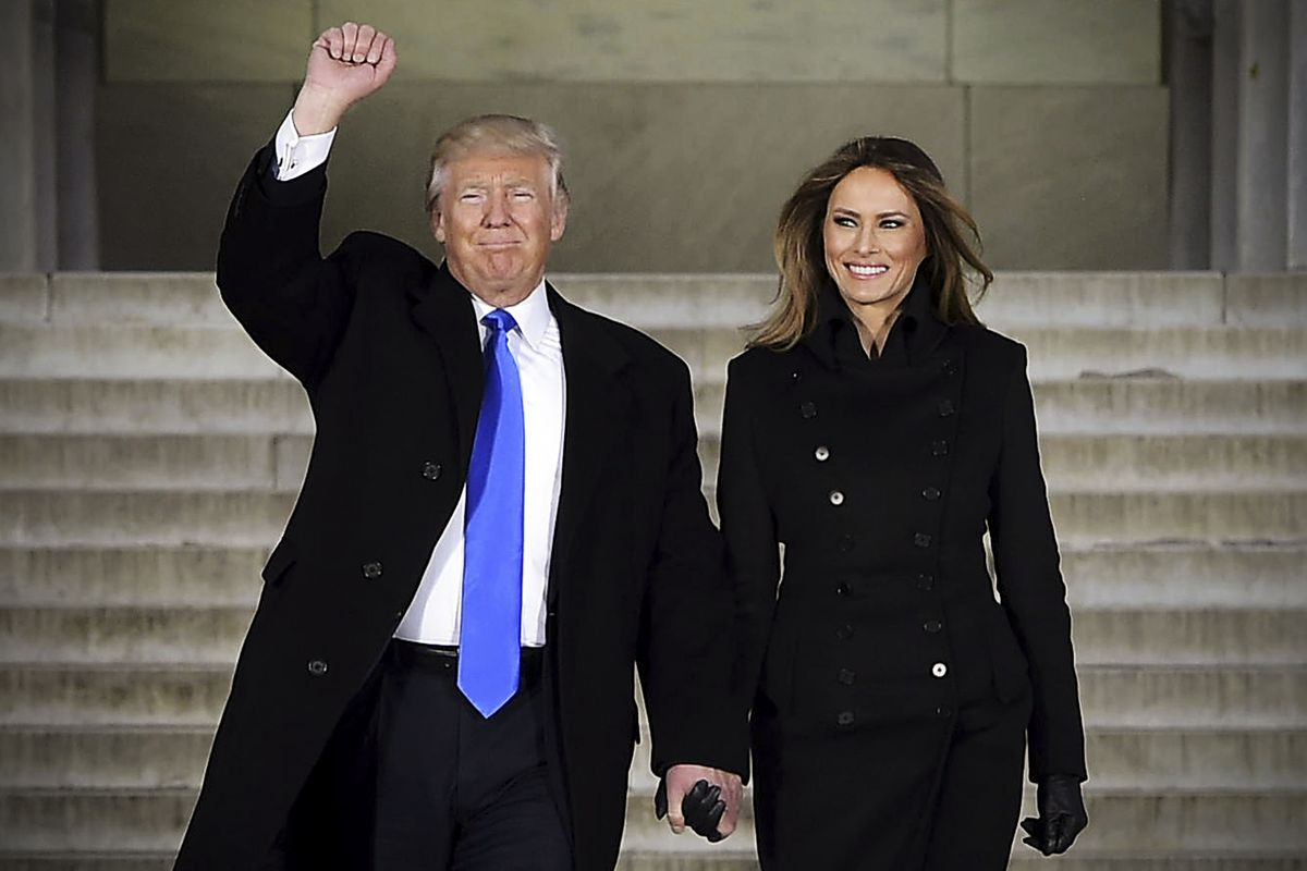 Donald Trump and his wife Melania attend an inauguration concert at the Lincoln Memorial.