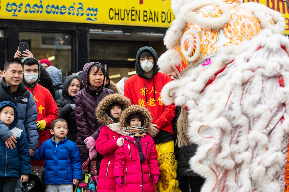 People watch a traditional Chinese Dragon dance Saturday at the Argyle Lunar New Year Parade in Uptown.
