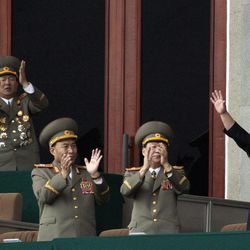 North Korean leader Kim Jong Un, left waves as North Korean military officers clap in a stadium in Pyongyang during a mass meeting called by the Central Committee of North Korea's ruling party on Saturday April 14, 2012. North Korea will mark the 100-year birth anniversary of the late leader Kim Il Sung on Sunday April 15.