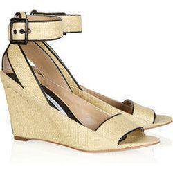 "<a href=""http://www.net-a-porter.com/product/190495"">Diane von Furstenberg Senegal leather-trimmed raffia wedge sandals</a> $125 (was $250)"