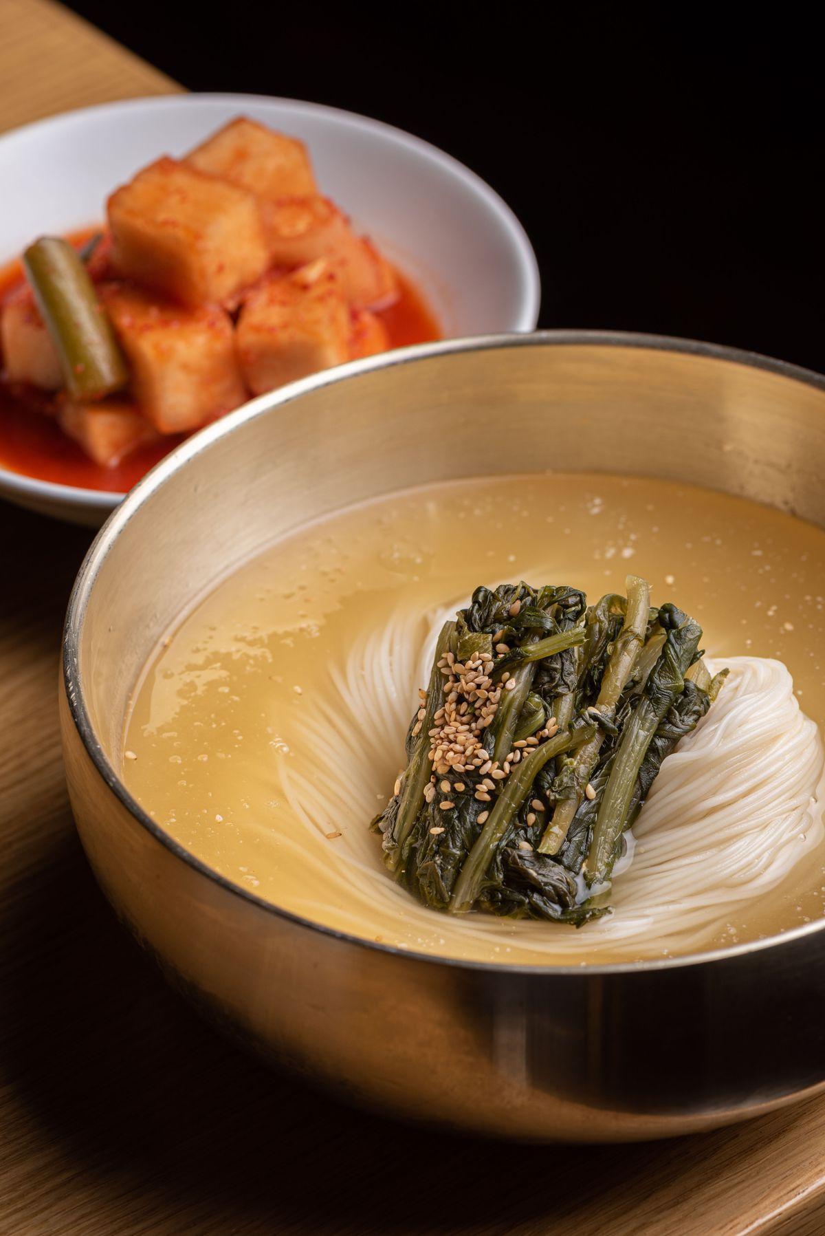 Cold yeolmu guksu (noodles) at Daedo in a steel bowl.