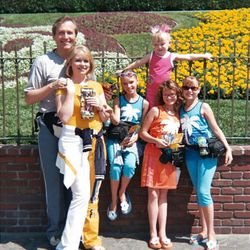 The MacNeill family — Martin, left, Michele, Sabrina, Giselle, Elle and Ada — pose for a photo while on vacation at Disneyland in California.