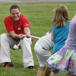 Former Utah cornerback Cal Beck plays tug-of-war with his third-grade class at Parkside Elementary School in August.