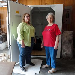 This April 27, 2012, photo provided by Betty Harryman shows Betty her daughter Linda Harryman with the safe room they installed in the garage of their new home following last years tornado in Joplin, Mo. Harryman, 76, was in a Joplin hospital about to have open-heart surgery when the twister hit.