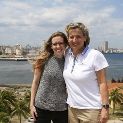"""Natalie Gochnour and her daughter stand in front of the """"Smile of Havana."""""""
