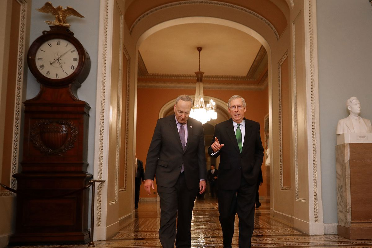 Senate Major Leader McConnell (R-KY) And Senate Minority Leader Schumer (D-NY) Walk To Senate Chamber Together After Budget Deal Reached