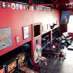 Red walls feature local artists: Lyle Sprauge's paintings on records and Jaime Lakatos' animal sculptures.