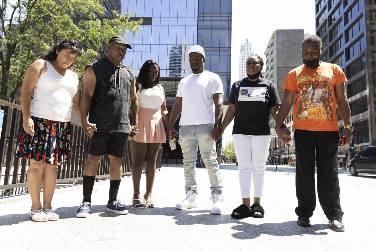 Norma Peterson, George Ivey,Ariana Walker, Joshua Williams, La Shann Walker and a supporter pray at the Daley Plaza after a press conference to bring attention to the ongoing missing persons case of King Walker and Diamond Bynum, Sunday, July 25, 2021.